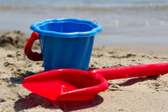 Children's beach toys - buckets and shovel on sand Stock Photos