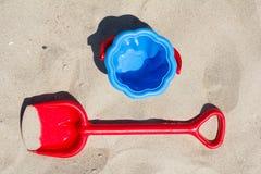 Children's beach toys - buckets and shovel on sand Stock Photo