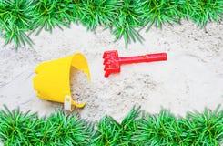 Children's beach toys. In grass border Royalty Free Stock Photos