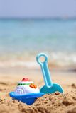Children's beach toys. Children's toys on a sand beach Royalty Free Stock Images
