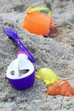 Children's beach toys on sand Stock Image
