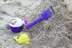 Children's beach toys on sand Royalty Free Stock Photography