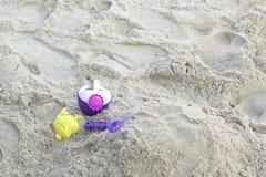 Children's beach toys on sand Stock Photos