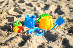 Children`s beach toys on sand on a sunny day Royalty Free Stock Image
