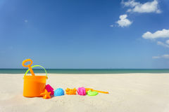 Children`s beach toys on sand on a sunny day Royalty Free Stock Photo