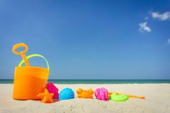Children`s beach toys on sand on a sunny day Stock Photos