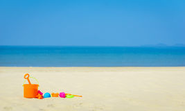 Children`s beach toys on sand on a sunny day Stock Photo