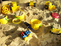 Children's beach toys on sand on a sunny day Stock Photos