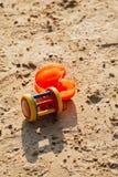 Children``s beach toys on sand at sunset tim Stock Photos