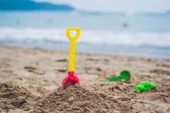 Children`s beach toys - shovel on sand Royalty Free Stock Photos