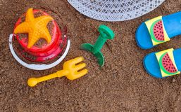 Children`s beach toys and summer accessories with space for your texts. Concept of happiness on summer and fun of children. Children`s beach toys and summer royalty free stock photo