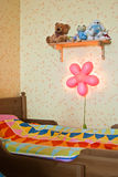 Children's bed and the included night lamp Stock Image
