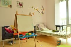 Children`s bedroom and Girls Playroom with Toys and Art Easel. Children`s bedroom and Girl`s Playroom with Toys and Art Easel royalty free stock image