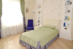 Children's bedroom in light tones. Modern classics with rococo e Royalty Free Stock Photo