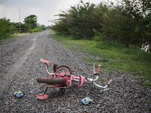 Children`s bicycle and shoe on stone road. missing children co royalty free stock photo