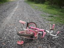 Children`s bicycle stone road. missing children co royalty free stock images
