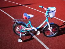 Children`s Bicycle with three wheels, small wheels can be removed royalty free stock photography