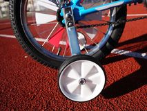 Children`s Bicycle with three wheels, small wheels can be removed stock image