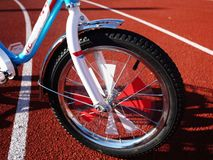 Children`s Bicycle with three wheels, small wheels can be removed royalty free stock image