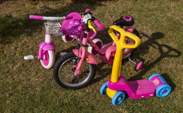 Children's Bicycles. Three child bicycles on lawn Stock Photo