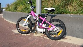 Children's bike chained Royalty Free Stock Photography