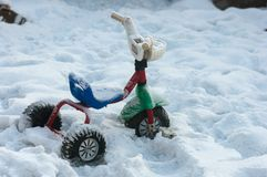 Children's bike in the snow. Thrown a little boy child bicycle snowbound Royalty Free Stock Photo