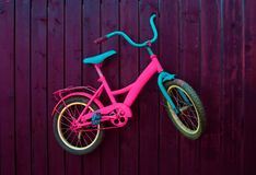 Children bike on the wall. royalty free stock photo