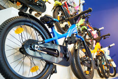Children`s bikes in storefront in the store Stock Image