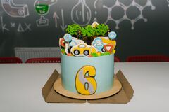 Children`s birthday cake for a 6 year old boy with cars