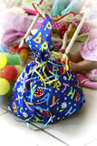 Children's birthday gift. In the background toys, stroller, doll, colorful balloons Royalty Free Stock Image