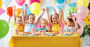 Children`s birthday. happy kids with cake. And ballons royalty free stock image