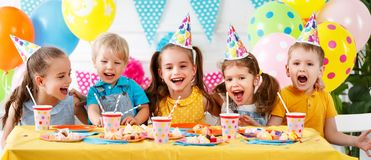Children`s birthday. happy kids with cake. And ballons royalty free stock photography