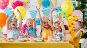 Children`s birthday. happy kids with cake. And ballons stock images