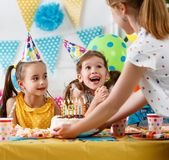 Children`s birthday. happy kids with cake. And ballons royalty free stock photos
