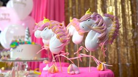Children`s birthday party. Unicorn themed treats, against colorful background. Close-up. Children`s birthday party. Unicorn themed treats, against a colorful stock video footage