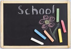 Children`s black Board for drawing with colored crayons with the inscription school.  stock images