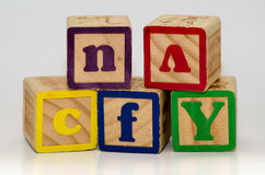 Children`s blocks. Children`s toys blocks stacking various colors and letters stock images