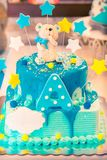 Birthday cake with teddy bear. Children`s blue birthday cake with letter A and teddy bear on the top, copy space Royalty Free Stock Image