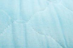 Children's blue cotton mattress Stock Images