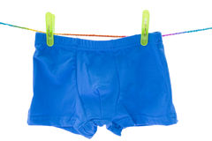 Children's blue swimming shorts isolated on white background. Children's orange swimming shorts isolated on white background with clipping path royalty free stock photo