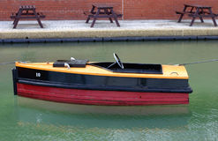 Children's Boat. A small motor boat, by the seaside in summer royalty free stock image