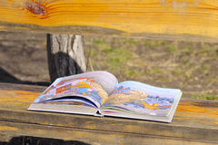 Children's book. The opened children's book lies on the street on bench Stock Photography