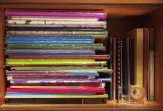 Children`s Books and Notebooks. Colorful children`s books and notebooks on shelf in closet Stock Image