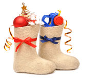 Children's boots with gifts Stock Photography