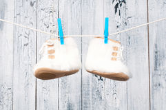 Children's boots hanging on a clothesline. Stock Image