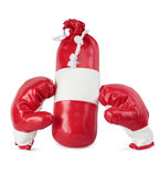 Children's boxing gloves and punching bag Royalty Free Stock Image