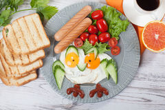 Children`s breakfast Cute fried eggs owl fun picture of food Royalty Free Stock Images