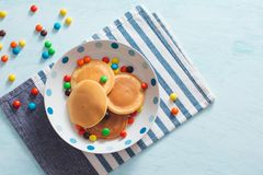 Children`s breakfast or dessert - pancake with colorful candies. Children`s breakfast or dessert - pancake with colorful candies royalty free stock image