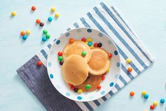 Children`s breakfast or dessert - pancake with colorful candies. Children`s breakfast or dessert - pancake with colorful candies stock photography