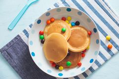 Children`s breakfast or dessert - pancake with colorful candies. Children`s breakfast or dessert - pancake with colorful candies royalty free stock photo
